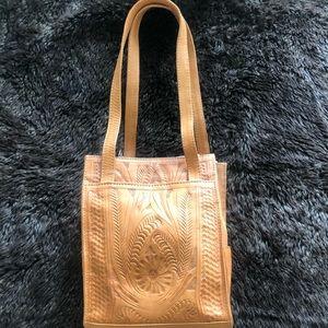 Tooled handbag